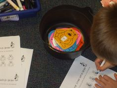 Pick a monster from the pot,  record the letter on the sheet.