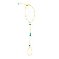 A delicate, yet very durable finger bracelet featuring genuine stones on a 14 kt gold-filled chain with extension. One size fits most. Available in turquoise, pyrite, labradorite, pearl, and black spi
