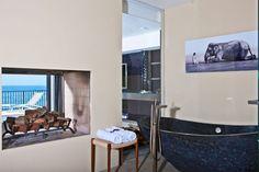 "This home is situated in Malibu, California. The proximity to the Pacific Coast Highway and being located on the ""Main Street"" in Malibu makes Malibu Beach House, Miami Beach, White Bathroom, Bathroom Interior, Master Bathroom, Modern Castle, Malibu Homes, Malibu Beaches, Cozy Fireplace"