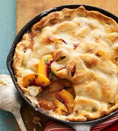 Grilled Skillet Peach Pie-grilled desserts -This warm-weather pie recipe makes the most of fresh juicy peaches. Grilling makes the crust tender and golden brown; top with fresh whipped cream or cinnamon ice cream food Fruit Recipes, Pie Recipes, Dessert Recipes, Cooking Recipes, Cooking Tips, Dessert Healthy, Recipies, Iron Skillet Recipes, Cast Iron Recipes