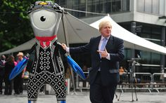 Mayor of London Boris Johnson stands with Olympic mascot Pearly Mandeville at the launch of first Team London Ambassador Pod in Spitalfields, London