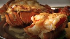 Lobster Thermidor: 1 1/2 pounds cooked lobster, 2 T butter, 1 minced shallot, 1 3/8 c fish stock, 1/4 c wine,  1/4 c Greek yogurt, 1/2 t dijon mustard,  1 T lemon juice, 2 T parsley, s & p, 1/4 c Parmesan cheese cook butter,shallot, fish stock, white wine & yogurt til reduced by half. Add mustard, lemon juice, parsley, s Broil lobster meat in shell w/sauce spooned over & Parmesan cheese on top for 3 to 4 minutes, just until golden brown. Serve immediately.