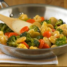 Orange Ginger StirFry Vegetables... A quick, colorful vegetable stir-fry recipe - big on flavor, but easy on prep time when using frozen veggies