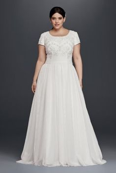 """Ethereal tulle elegantly flows out from the attached sash waist band of this modest, but stunning plus size extra length wedding dress with short sleeves. Allover beading adorns the scoop neck bodice. David's Bridal Collection Plus size with 4"""" extra length Polyester Sweep train Back zipper; fully lined Dry clean Imported Also available in Regular Plus Size Petite and Extra Length"""