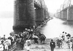 30th June, 1950, Refugees crossing Han river on a floating bridge temporarily made because the bridge was blown up. At that time, North Korean soldiers already reached at Han river and watched them.