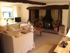 The beamed sitting room has a large inglenook fireplace containing a woodburning stove