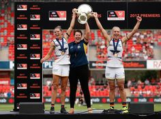 Erin Phillips Photos Photos - (L-R) Chelsea Randall, Bec Goddard (Coach) and Erin Phillips of the Crows hold the cup aloft after winning the inaugural AFLW Premiership during the 2017 AFLW Grand Final match between the Brisbane Lions and the Adelaide Crows at Metricon Stadium on March 25, 2017 in Gold Coast, Australia. - AFL Women's Grand Final - Brisbane v Adelaide