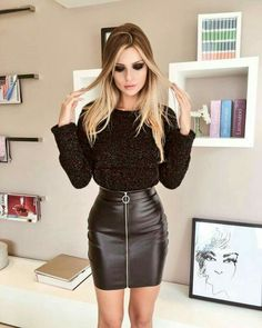 Blonde in front zip black leather skirt and sweater