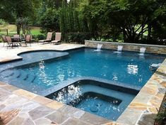 This pool has everything from the spa and the waterfalls to the sun deck with splash pad! Big Pools, Small Backyard Pools, Backyard Pool Designs, Swimming Pools Backyard, Swimming Pool Designs, Pool Landscaping, Indoor Pools, Small Pools, Pool Decks
