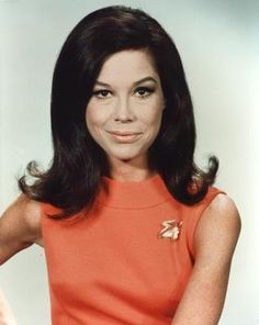 "One of the 1960s' signature hairdos has endured over several decades.    ""The Flip"" was hip and initially favored by younger women-shoulder-length hair was backcombed slightly at the top and then curled out at the ends. (Mary Tyler Moore)"