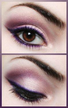 Purple eye makeup with purple eyeliner and black flick.