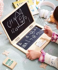 At first glance, Our Byte-Size Personal Laptop Chalkboard resembles a real laptop, but no batteries are required to get started. Portable and powered completely by imagination, it's perfect for every kid on the go. The chalkboard features two writing surfaces and a convenient inlay for holding chalk.