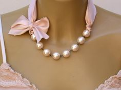 Carrie Bradshaw  Inspired Pearl Necklace In Nude Color Satin Ribbons. Perfect for Bride, Wedding, Bridesmaids And Formal. $49.00, via Etsy.