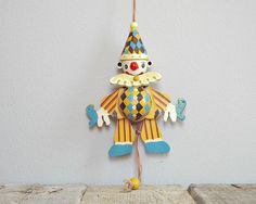 WOODEN toy, wood jumping jack, vintage pull doll, retro plywood clown pull toy, children's wood joker, nursery decoratio