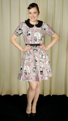 This dress is to die for! It's a vintage shape with nice black rounded peter pan collar, slimming black waistband, and short puff sleeves. It features an Edward Gorey inspired print of pictures frames with members of the Ghastlie and Grislie family. It has a center back zipper and the waistband is elasticized in the back for a good fit. 100% cotton, machine washable and Made in the USA. $74