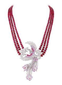 Van Cleef & Arpels - Oiseau Flamboyant from Couleurs de Paradis 2011. Red spinel , pink sapphires.