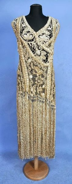 Stunning Ribbon Embroidered Lace Over-Dress - 1920's - Sleeveless ivory net decorated with heavy padded silk embroidery and French knots to below the hip, having a skirt of long ribbon fringe - Whitaker Auction - @~ Mlle