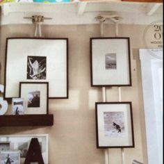 Cute picture hanging idea. Cleats on the wall with rope hanging down and pictures hanging from the rope. So cute.