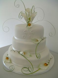 3 tier white wedding cake with hand made calla lily flowers.