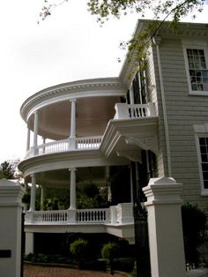 love the double round porch