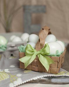 DIY Easter Egg Basket made out of a brown paper bag.                            http://www.elli.com/blog/diy-grocery-bag-easter-basket/