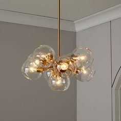 Staggered Glass Chandelier, Round -9 Light, Antique Brass/Clear
