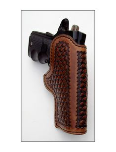 Custom leather holster designed for a 1911 auto pistol with a 3½ inch barrel.