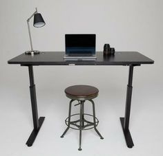 The Stand Desk can adjust to standing or sitting heights at the press of a button.