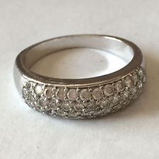 Sterling silver rhodium plated white roung faceted CZ pave set ring,... Lot 166