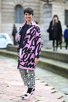 The European Guide To Flawless Style #refinery29  http://www.refinery29.com/milan-fashion-week#slide6  In this case, the writing's on the coat. Black stockings also allow you to bust out your spring shoes early.