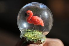 A miniature retro lawn flamingo to take everywhere you go! Handmade glass bubble ring / snow globe ring / terrarium ring on an adjustable brass