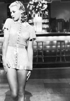 Ginger Rogers wears a button dress