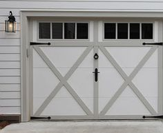 I love a beautiful garage door - if it's on the front of your house, it's a Must! It takes up such a large space that it can be a great architectural feature.