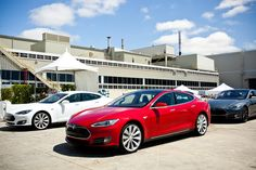 delivery of one of the first 10 full-size, fully electric, U.S.-built [Tesla S] sedans.