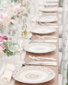 Two different china patterns were used to create these eclectic table settings atop walnut farm tables