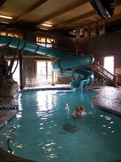 Tube slide in indoor pool from upstairs gym area