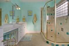 Playful teal is incorporated into this otherwise beige bath.