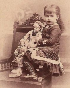 Pouting girl with French dolls c1880