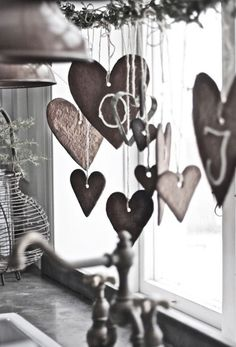 Wooden shaped hearts that have been arranged and bundled together like wind chimes. It gives a very homey and simple vibe perfect for your home along the beach where the wind can dance with it.