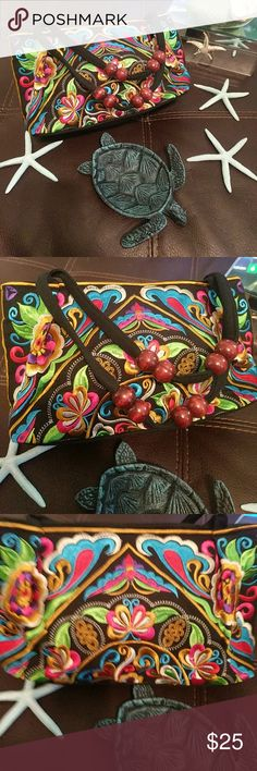 NWT Embroidered Purse Imported from a collective of Chinese artisans, this handmade bag is one of a kind. Approximately 5x9, this purse is perfect for holding your makeup at a festival Bags Mini Bags