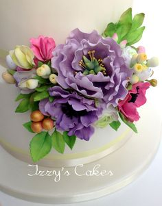 Edible sugar flowers (peony, anemone, sweet pea) to match the bride's bouquet. Perfect for a Spring wedding!