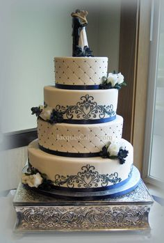 Google Image Result for http://www.jacquiscakes.com/photos/Weddings-amp-Anniversarys/Elizabeth%27s%2520Blue%2520Scroll%2520Wedding%2520Cake.jpg
