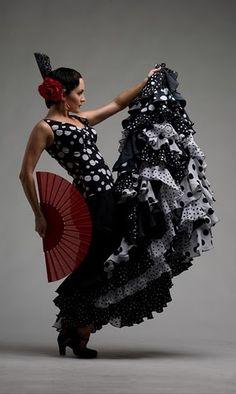 Flamenco dancer from Spain. Beautiful hair flowers at http://www.MyArtDeco.co
