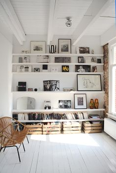 White shelves with various artwork.