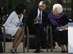 First Lady Michelle Obama, left and former first lady Barbara Bush listen as President Barack Obama speaks