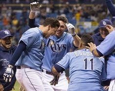 Jose Lobaton, left, gets mobbed as he hops onto home plate after homering to rightfield to win it in the 10th inning. Lobaton now has 2 walkoff hits in 3 days. His parents have been here from Venezuela to watch him play for the 1st time in the US. Chris Archer delivers 7 sharp innings to keep Rays in the game. Rays beat Blue Jays 2-1. (8-18-13)