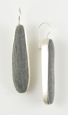 Beach stone and sterling silver earrings, by Jennifer Nielsen. I love how these are huge chunky earrings that still manage to be somehow quietly stylish. the idea of using beach pebbles is lovely