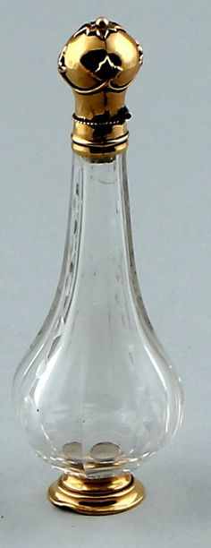 Crystal perfume bottle with gold base, collar and cap, with crystal stopper. Hollands 14ct.