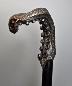 A sculpted raven skull cane measures 38 tall. The head is x 3 cast in a durable resin infused with iron powder. The stick is black varnished Cannes, Octopus, Raising Canes, Cane Tips, Walking Staff, Steampunk, Baguette, Cane Handles, Walking Sticks And Canes