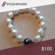 Stretchy Bracelet. Stretchy Bracelet with a Tahitian Pearl in the Center surrounded by South Sea Pearls. Jewelry Bracelets